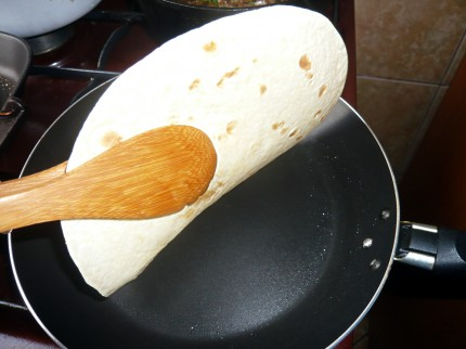 Flipping the tortilla in the pan
